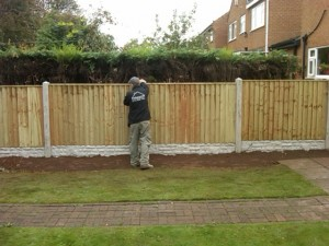 Wooden fence panels on concrete gravel boards
